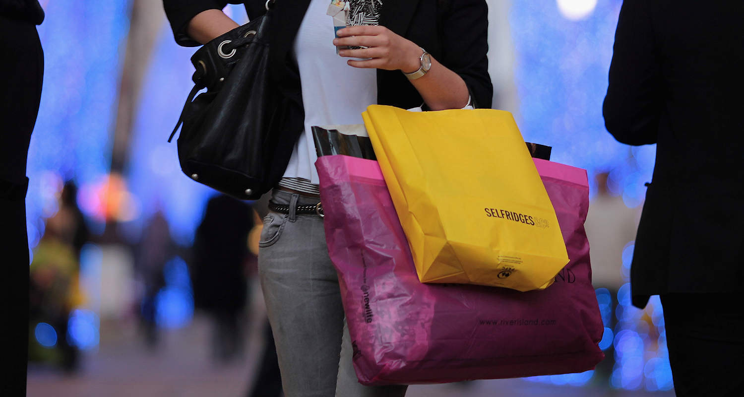LONDON, ENGLAND - DECEMBER 14:  A woman carries shopping bags off New Bond Street on December 14, 2009 in London, England. High street stores are expecting a bumper Christmas this year despite the economic dowturn, with shoppers spending around GBP £120 million in the past two days alone.  (Photo by Dan Kitwood/Getty Images)